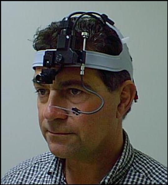 man wearing retina tracking device